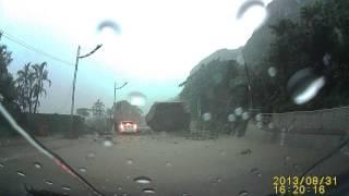 Huge boulder nearly crushes car