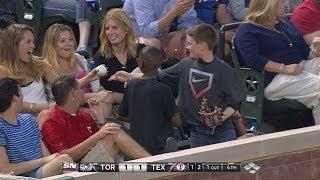 Young fan gives ball to pretty lady, really?