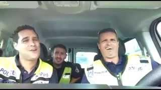 "Three Israeli policemen singing ""The Lion Sleeps Tonight"""
