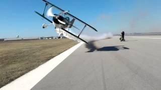Airplane barely hitting two people