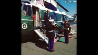 Obama saluting marines with coffee cup in hand