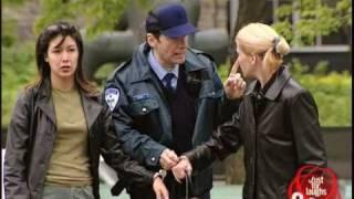 Cop handcuffs innocent bystanders with a criminal
