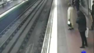Man (almost) run over by train. Hero saves his life.