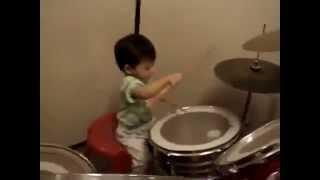 1-year old asian baby play drums