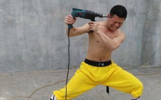 Kung-fu master holds a running power drill against his head for 10 seconds without injury