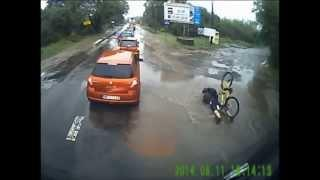 Biker falls face first into large puddle