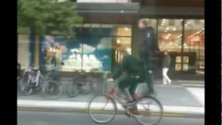 Guy standing on bicycle rack during ride