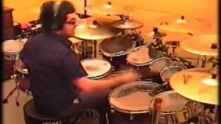 Guy playing the drums to classical music.