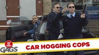 Car hogging police officers